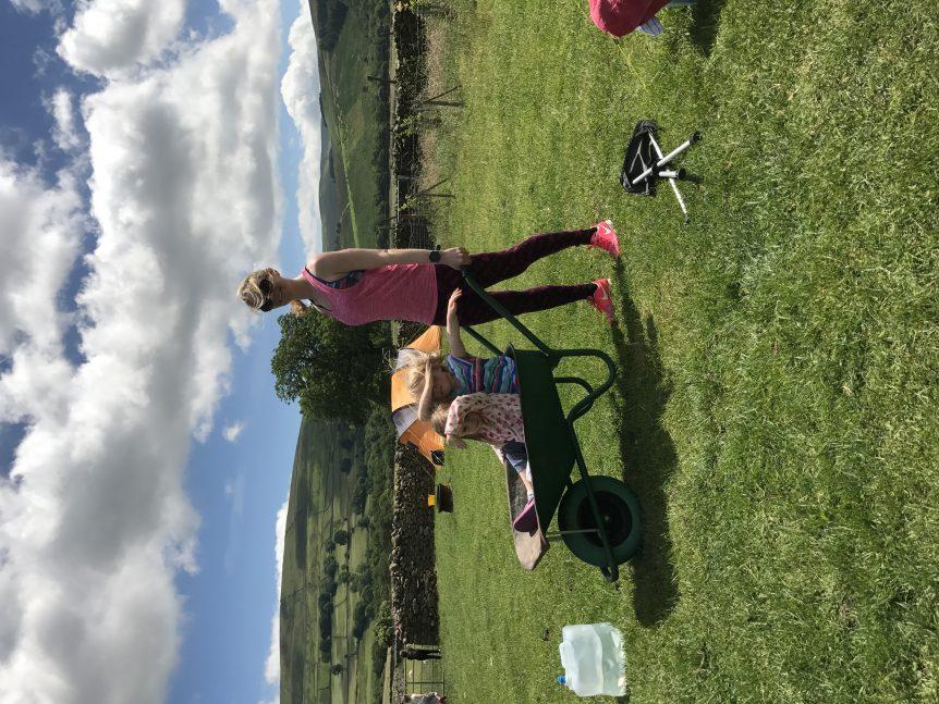 training with a wheelbarrow full of kids